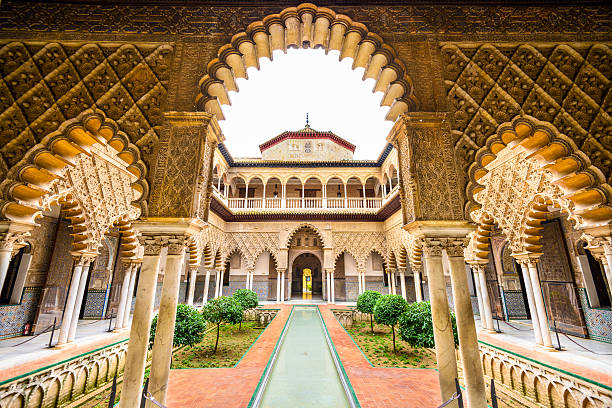 Alcazar of Seville Seville, Spain - November 7, 2014: The Royal Alcazar of Seville at the Courtyard of the Maidens. It is the oldest royal palace still in use in Europe. alcazar palace stock pictures, royalty-free photos & images
