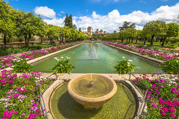 Alcazar de los Reyes Cristianos Cordoba, Andalusia, Spain - April 20, 2016: The popular gardens with fountains of Alcazar de los Reyes Cristianos, a popular tourist attraction of Cordoba, Andalusia, Spain. Unesco Heritage Site. cordoba spain stock pictures, royalty-free photos & images