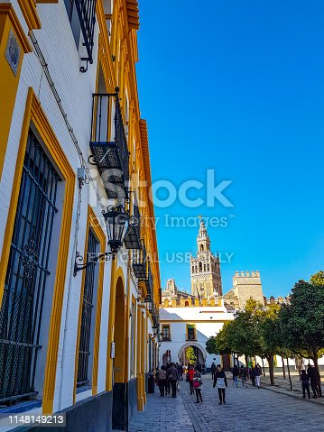 The rear of the Alcazar Palace offers a view on the Giralda in Sevilla in February 2018