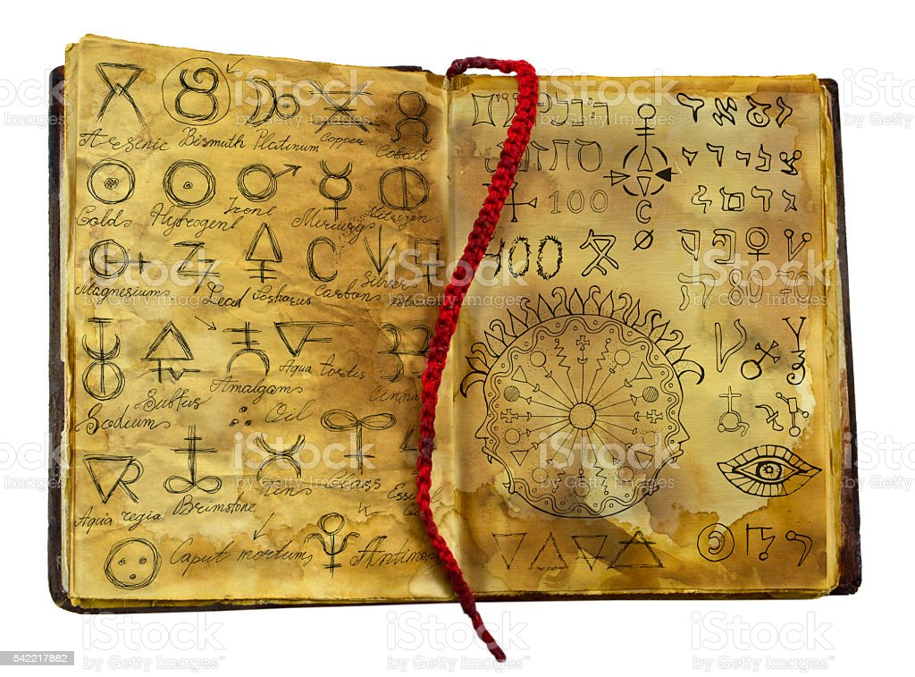 Alchemic book with mystic and fantasy symbols isolated stock photo