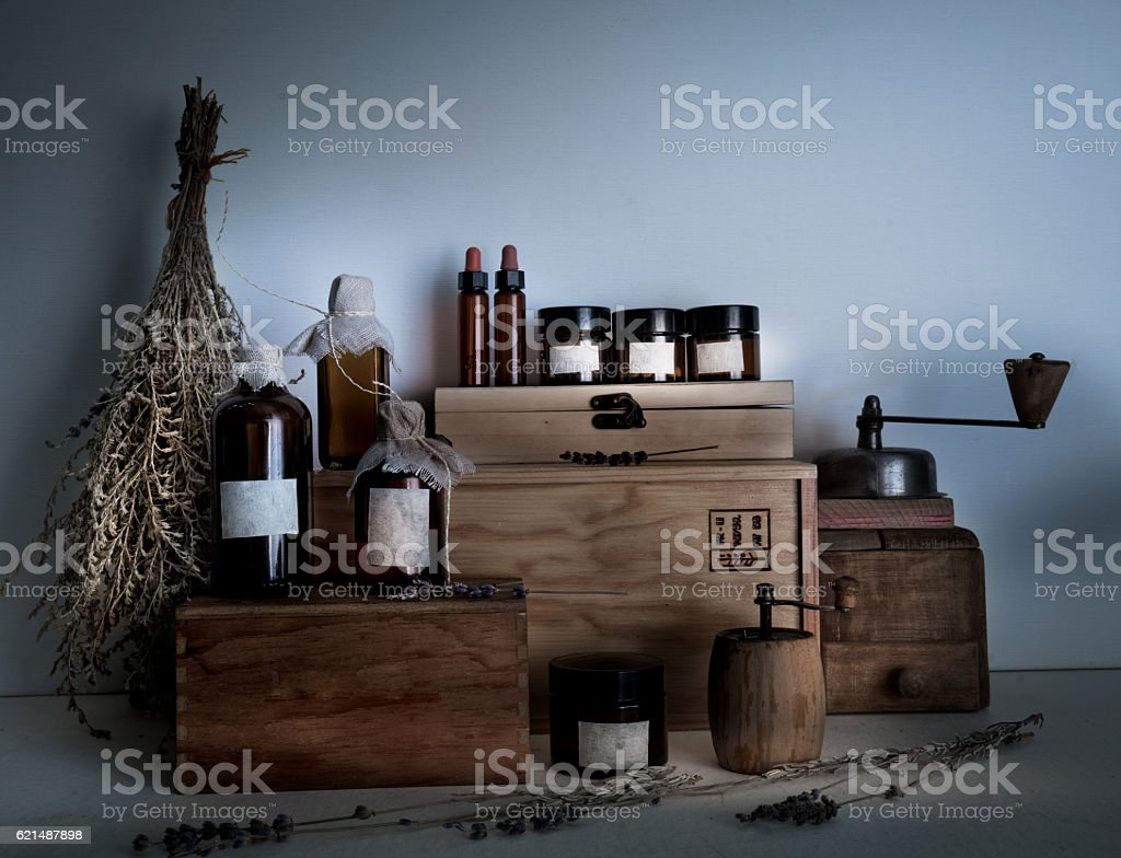alchemy lab. bottles, jars, dried wormwood bouquet on wooden shelves Lizenzfreies stock-foto