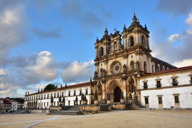 Alcobaca Monastery, Portugal The Alcobaca Monastery is a Mediaeval Roman Catholic monastery located in the town of Alcobaca  shown at sunset. The church and monastery were the first Gothic buildings in Portugal abbey monastery stock pictures, royalty-free photos & images