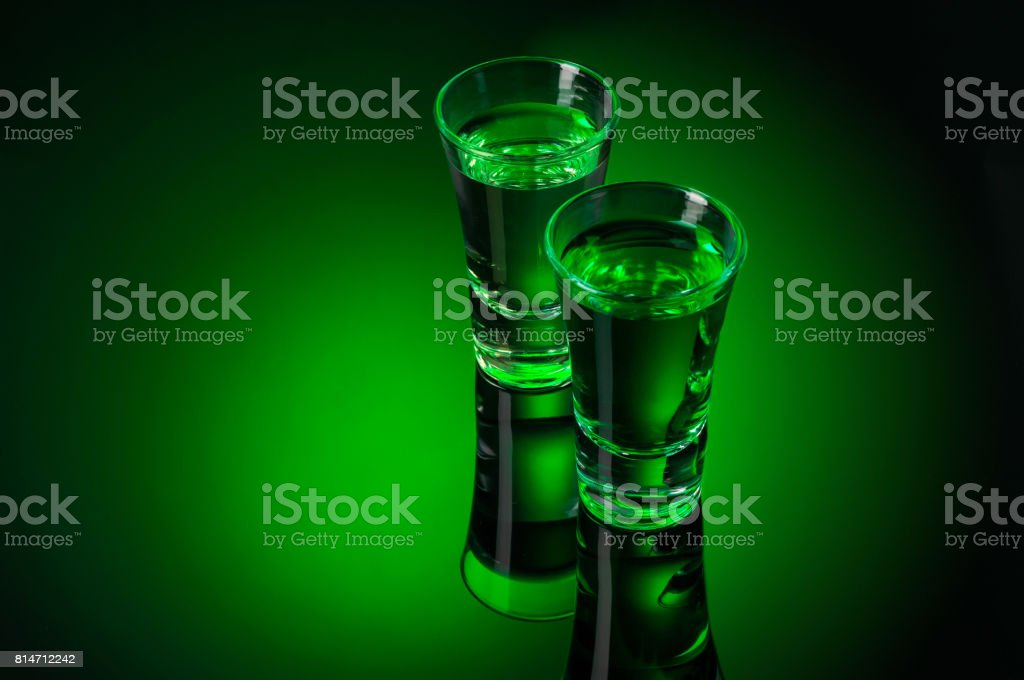 Alcohol Absinthe shots on black background stock photo