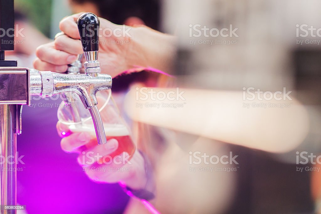 Alcohol Abuse, pouring beer at the party outside stock photo