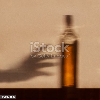 istock Alcohol addiction concept 528638839