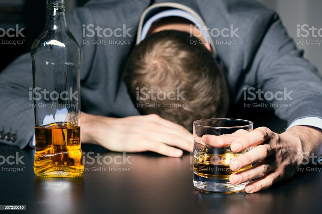 alcohol addiction - drunk businessman holding a glass of whiskey​​​ foto