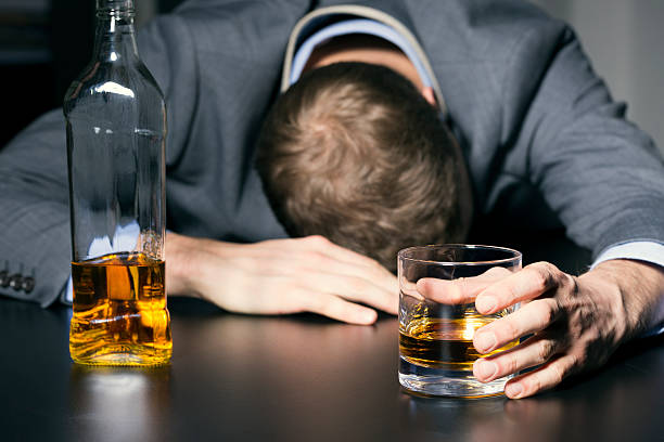 alcohol addiction - drunk businessman holding a glass of whiskey - dipsomania stock pictures, royalty-free photos & images