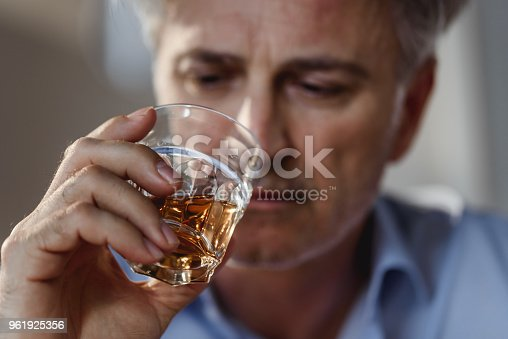 Man drinking whiskey. Alcohol addiction concept.