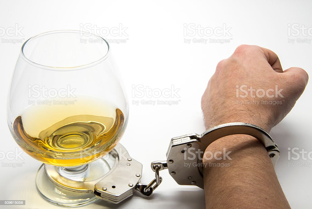 Alcohol and handcuffs stock photo