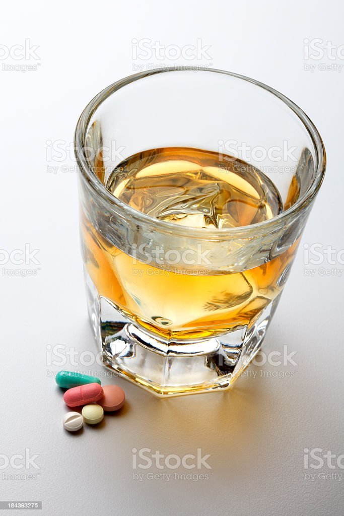 Alcohol and Prescription Medication On Light Gray Background royalty-free stock photo