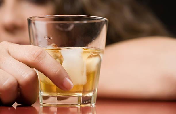 Alcohol and sorrow stock photo