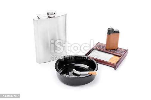 Flask, ashtray, some cigarettes and lighter on a cigarette case isolated on white background