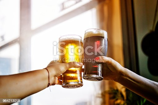 alcohol. two man cheers and clinking glass of beer drinking and toasting outdoor after work. octoberfest, party,