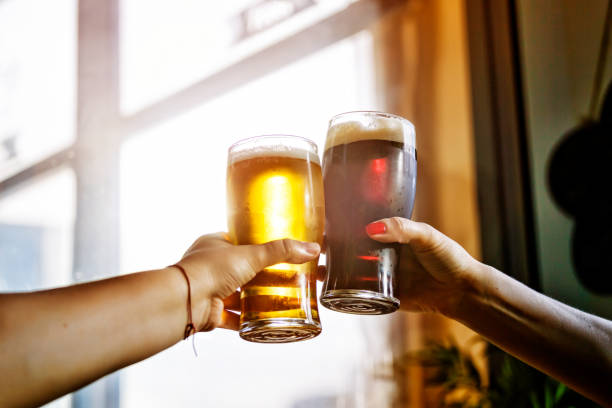 alcohol. beer, octoberfest, party, celebratory toast, men, drink - honour stock photos and pictures