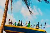 Background image Alcohol Bottle Collection at summer outdoor