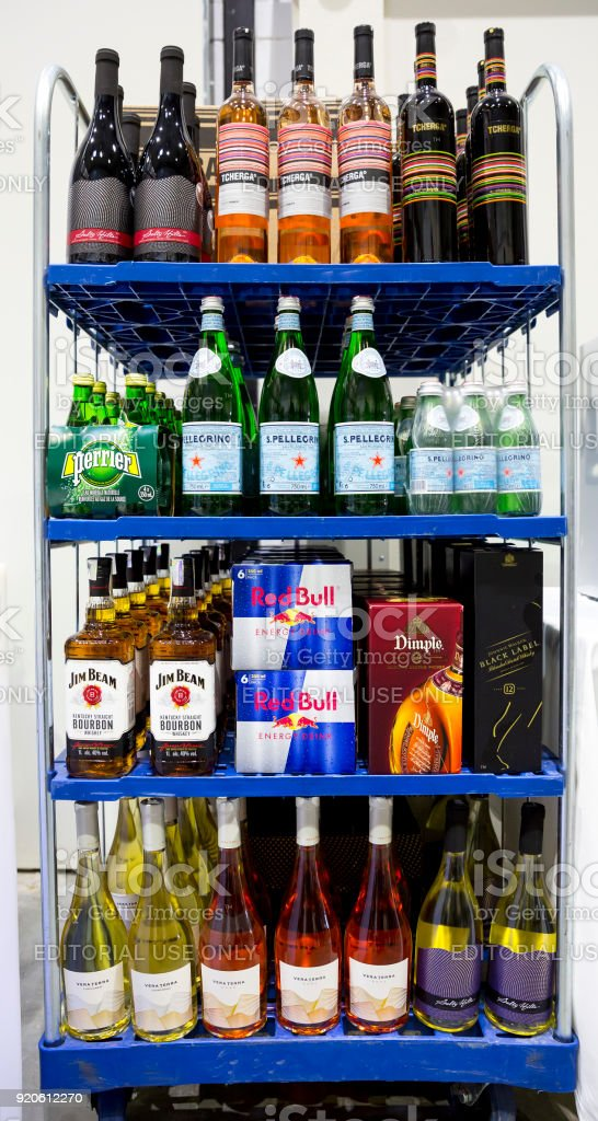 Alcohol bottles on a shelf stock photo