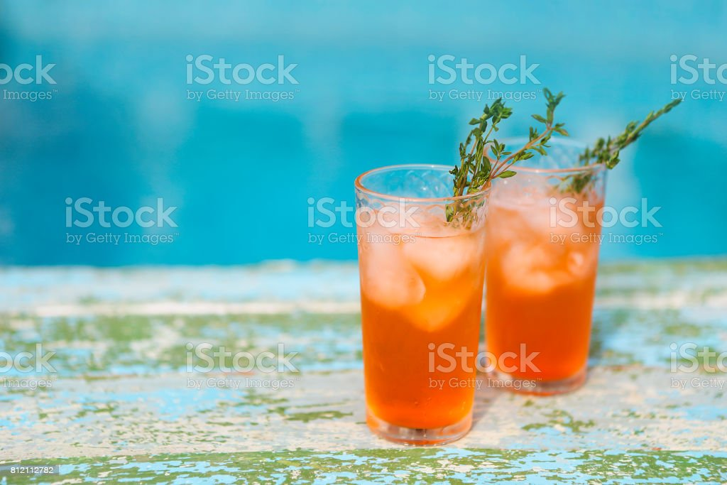 Alcohol cocktail on turquoise background stock photo