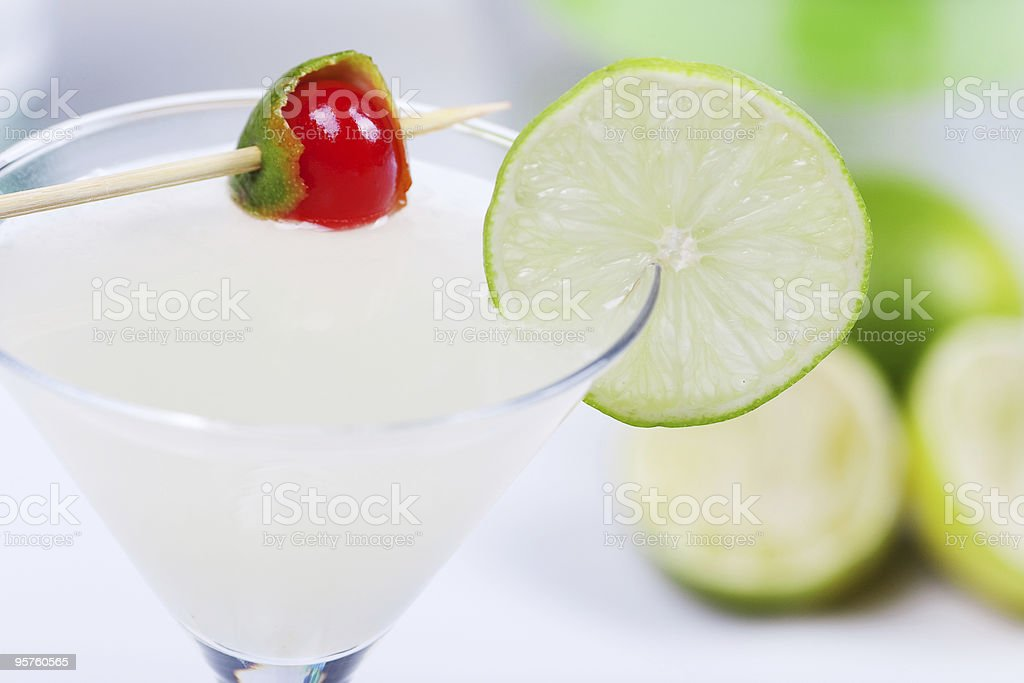 Alcohol cocktail with lime juice royalty-free stock photo