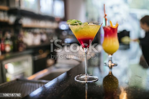 Close-up of alcohol cocktails on the bar counter in nightclub