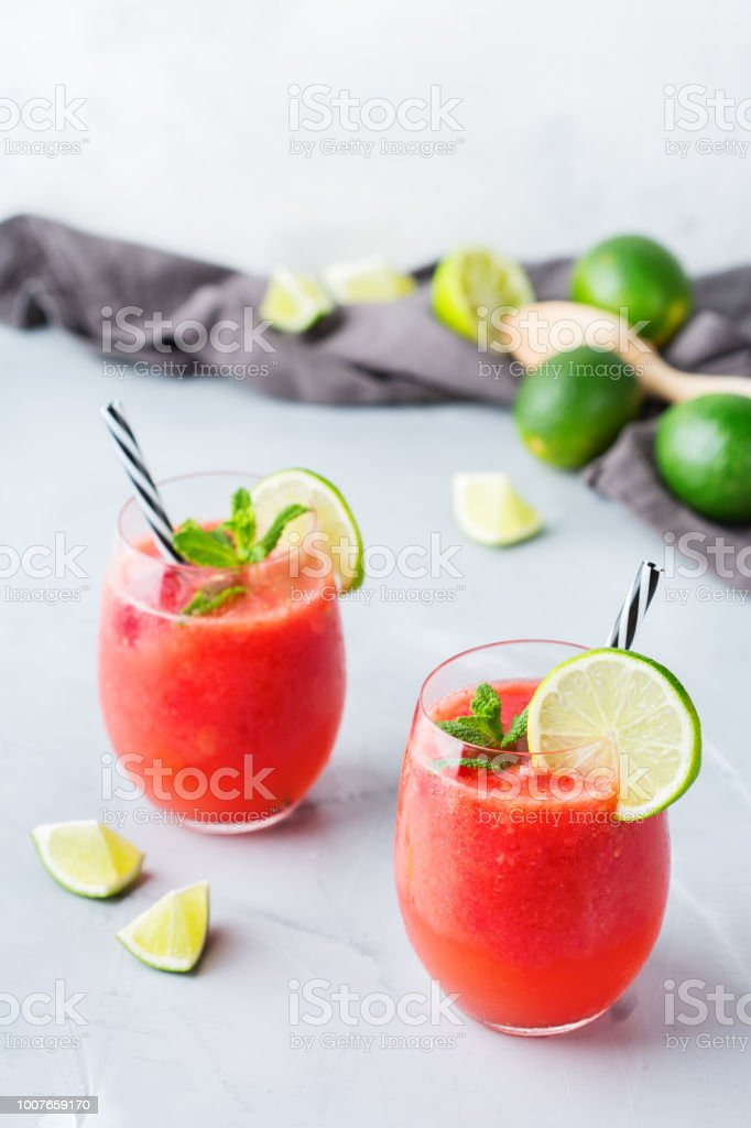 Alcohol drink red watermelon cocktail for summer days stock photo