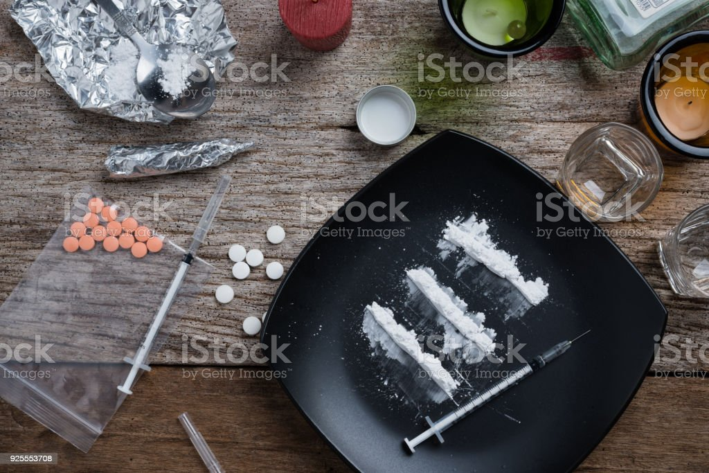 alcohol, drugs, pills on a wood background stock photo
