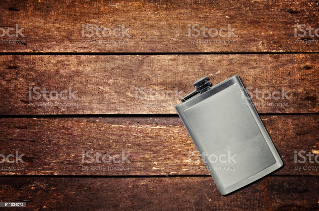 Alcohol flask on the table - foto stock