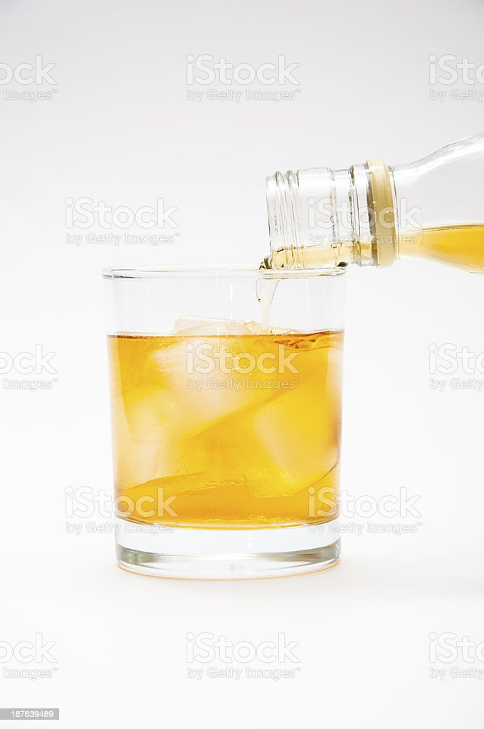 Alcohol flowing from the bottle stock photo