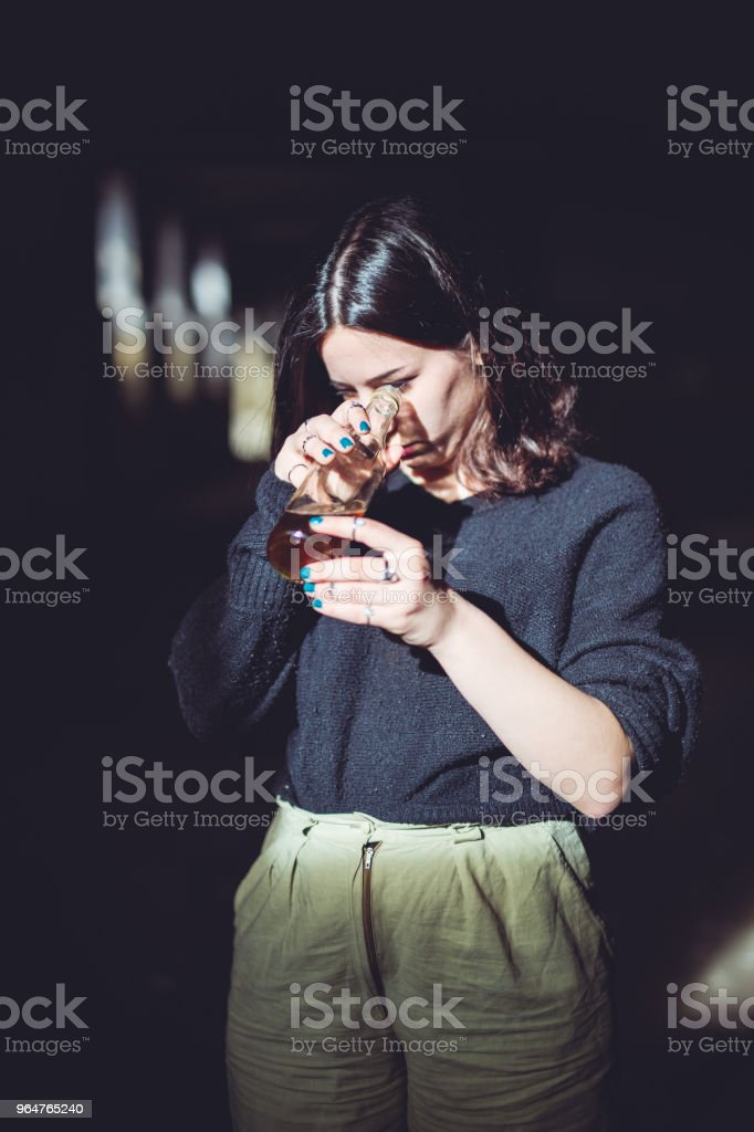 Alcohol fueled melancholy royalty-free stock photo