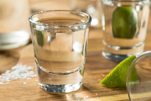 Alcohol Mezcal Tequila Shots Alcohol Mezcal Tequila Shots with Lime and Salt tequila shot stock pictures, royalty-free photos & images