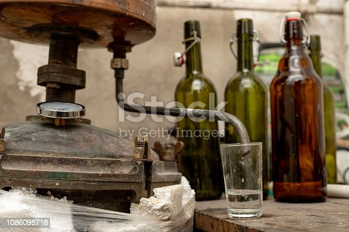 Alcohol production in home conditions. Accessories for the production of homemade moonshine. Place - home basement.