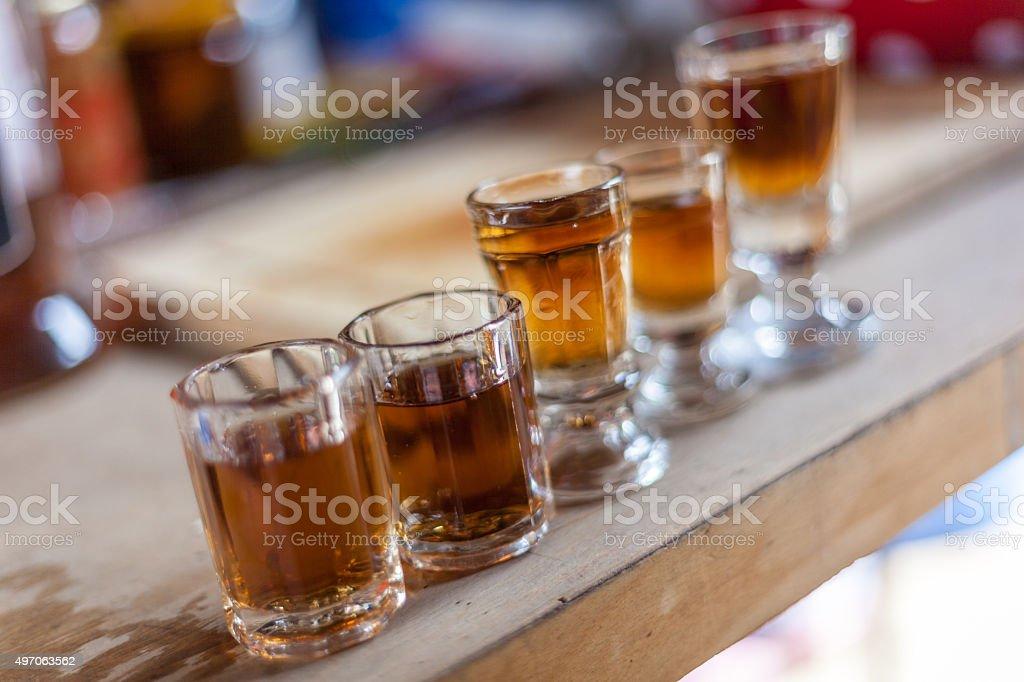 Alcohol shots in vintage shot glasses stock photo