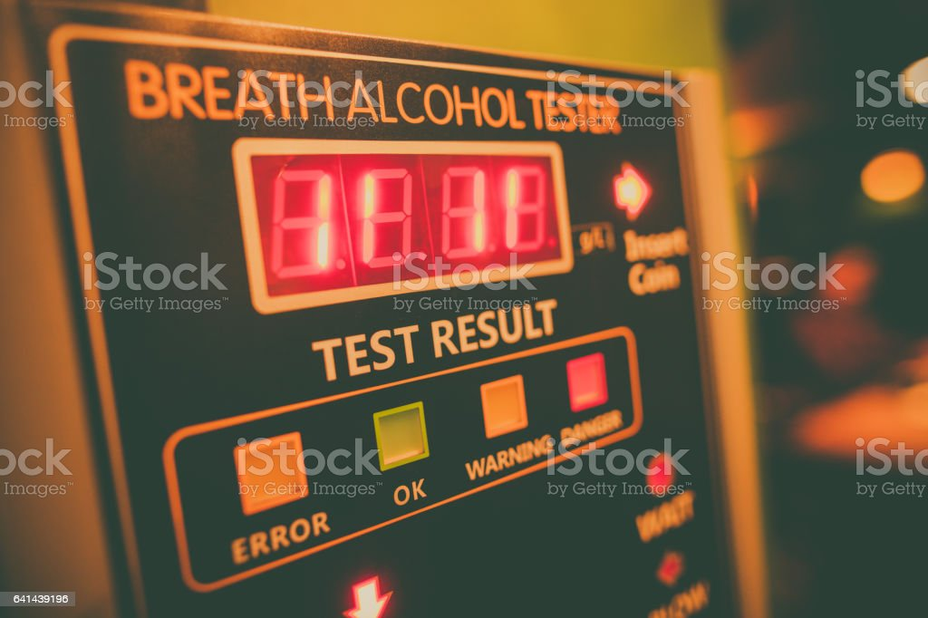 Alcohol tester on a wall stock photo