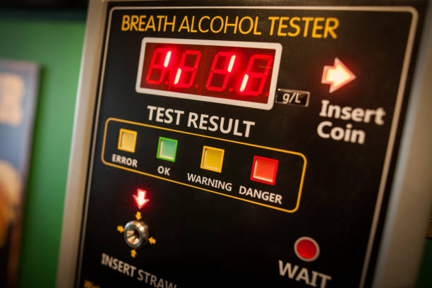 Alcohol tester on a wall - foto de acervo