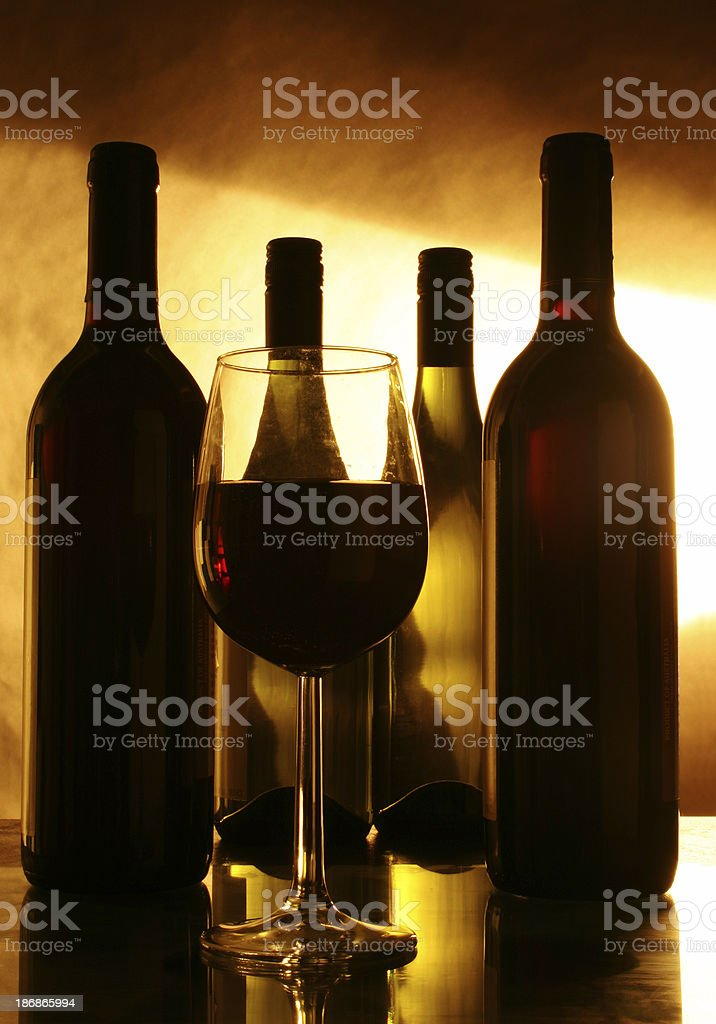Alcohol - Wine glass and bottles royalty-free stock photo