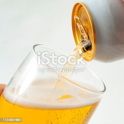 istock Alcoholic beverage, drinking alcohol and alcoholic content concept with close up on a hand pouring from a can of beer into a clear glass isolated on white background 1124901962