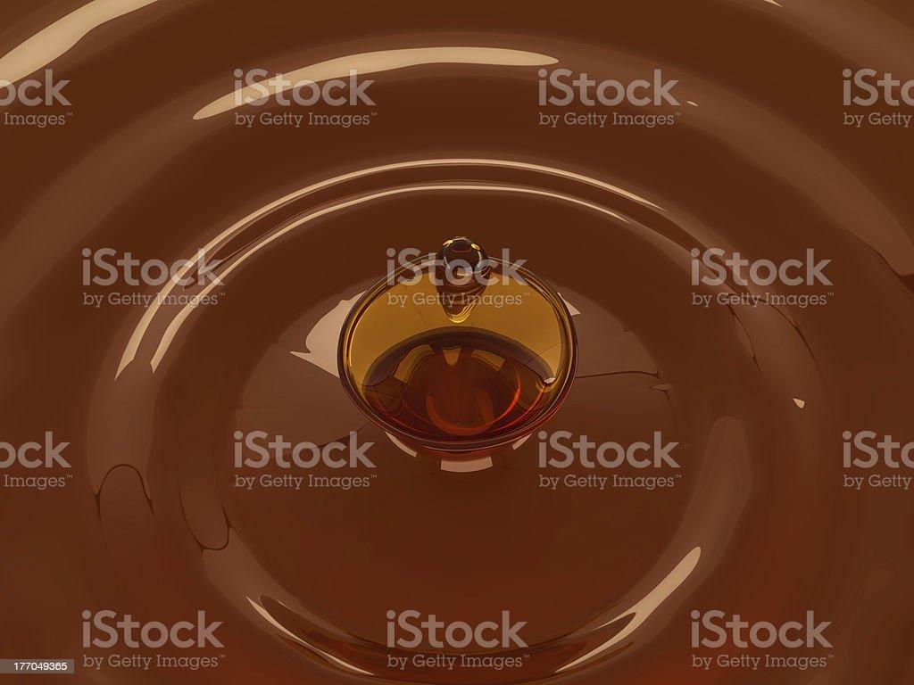 Alcoholic beverage splash with droplet: whisky royalty-free stock photo