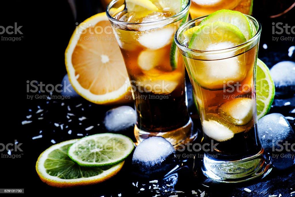 Alcoholic cocktail coconut cola, liqueur, lime, lemon and ice stock photo