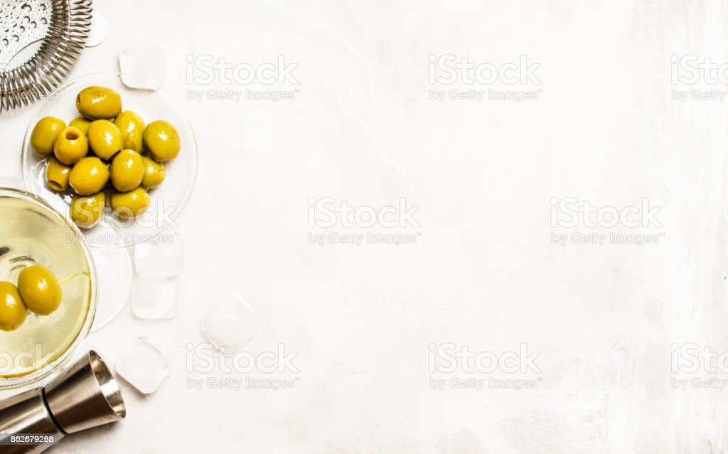 Alcoholic cocktail with green olives stock photo