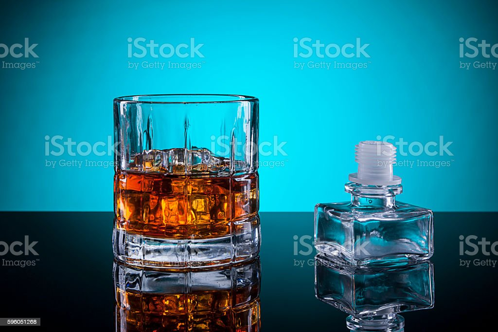 Alcoholic drink and glass stopper. royalty-free stock photo