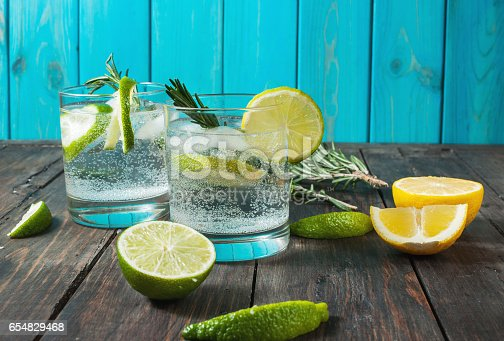 istock Alcoholic drink gin tonic cocktail with lemon, rosemary and ice 654829468