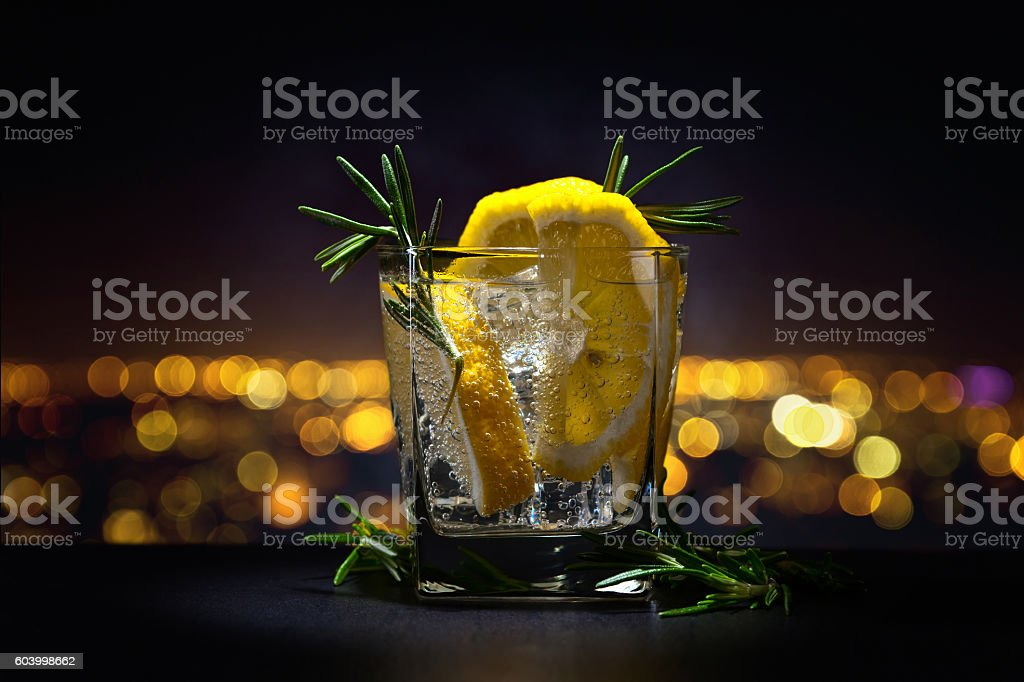 alcoholic drink with tonic, lemon and rosemary stock photo