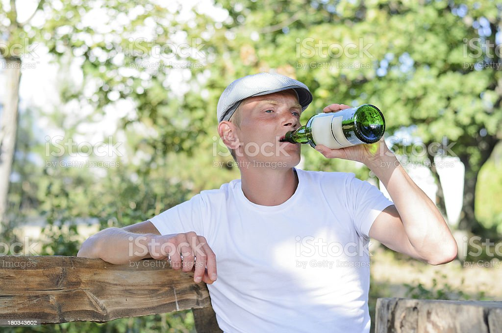 Alcoholic drinking from a bottle of spirits royalty-free stock photo