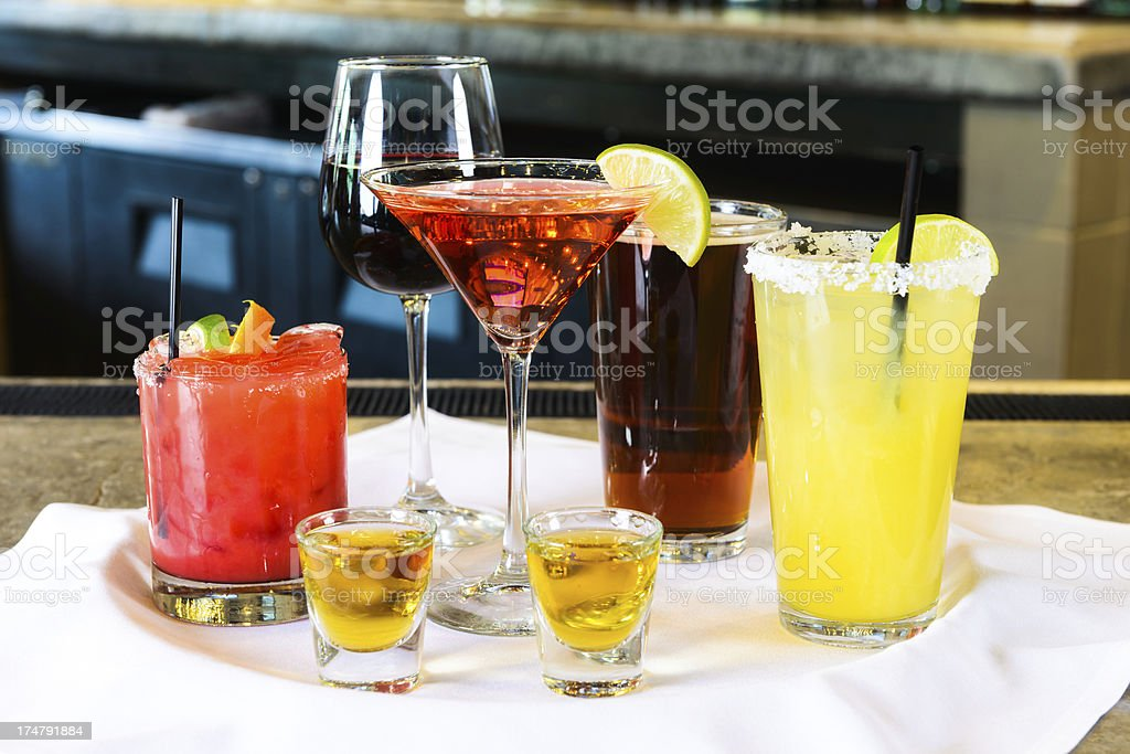 Alcoholic Drinks on Tray at Bar stock photo