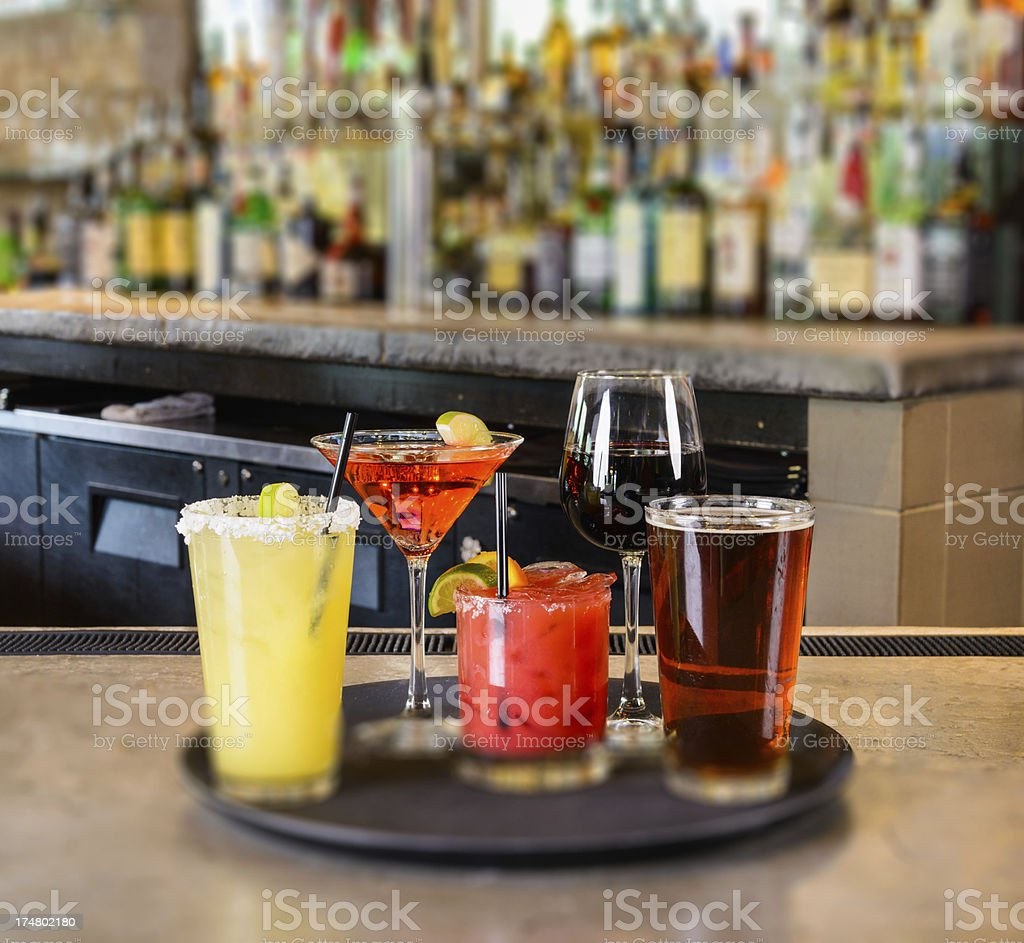 Alcoholic Drinks on Tray at Bar stock photo