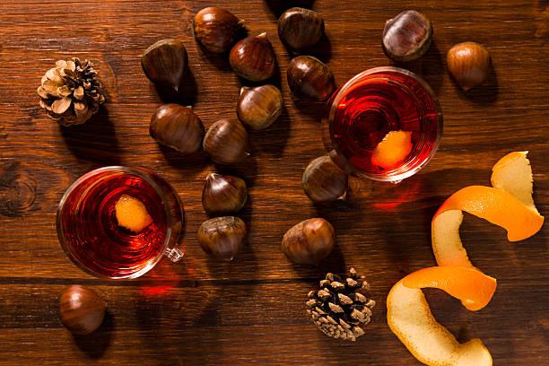 alcoholic punch drink, chestnuts and pine cone - heisse maroni stock-fotos und bilder