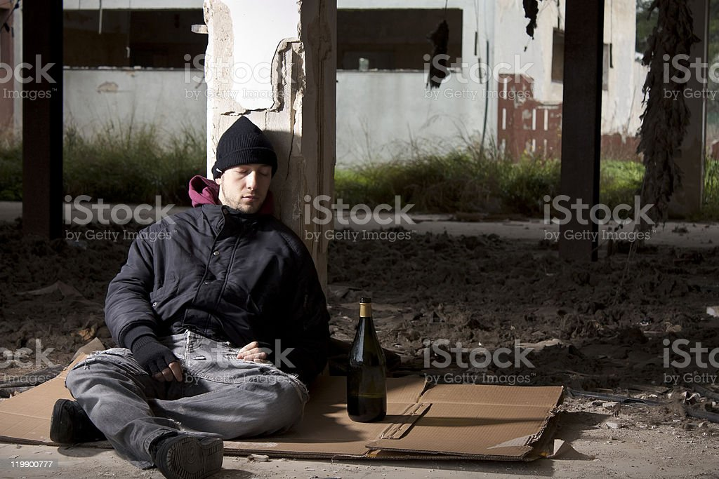 Alcoholic Sitting on the Floor royalty-free stock photo