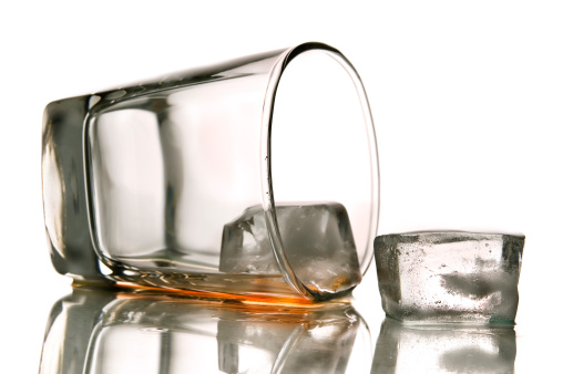 tipped over glass of alcoholic drink. View more drinks