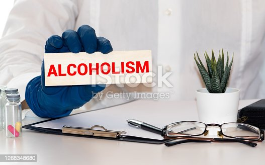 alcoholism word in a dictionary. alcoholism concept, definition.