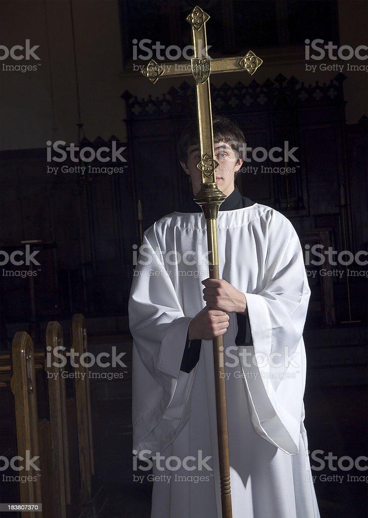 Alcolite Holding Cross in Darkened Church stock photo