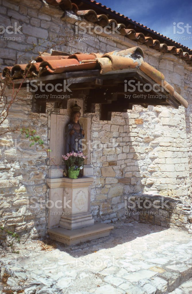 Alcove and religious icon at historic church and mission Carmel California stock photo